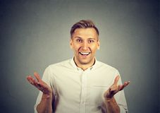 Happily surprised man looking at camera royalty free stock photography