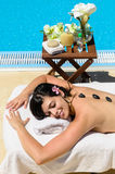 Happines in spa. Woman relaxing and sunbathing in spa club at poolside in summer Royalty Free Stock Photography