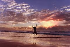 Happiness. Woman celebrating her success at sunrise Royalty Free Stock Photo