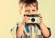Happiness. Little boy with a Camera, studio Stock Photo