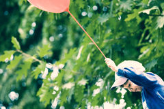 Happiness. Happy boy with balloon at summer park Royalty Free Stock Photography