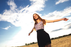 Happiness. Candid skipping carefree adorable woman in summer field Stock Photo