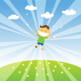 Happiness. Smiling boy jumping in the blue sky of spring Royalty Free Stock Images