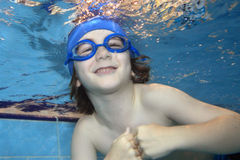 Happiness. Underwater picture of a young boy swimming and playing Stock Photo