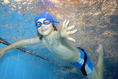 Happiness. Underwater picture of a young boy swimming and playing Royalty Free Stock Images