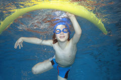 Happiness. Underwater picture of a young boy swimming and playing Royalty Free Stock Photo