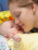 Happiness. Smiling persons of mother and the child close up Stock Photo