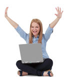 Happiness. Happy young blonde woman raising hands while sitting with a laptop in her lap Stock Images