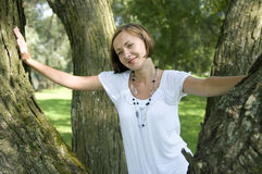 Happiness. Young blonde attractive woman and trees Royalty Free Stock Photography