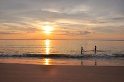 Happiness. Children fun and happy on the beach under sunset light Stock Images