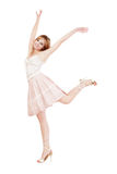 Happiness. Pretty young blond girl dancing with happy smile on white background Royalty Free Stock Photos