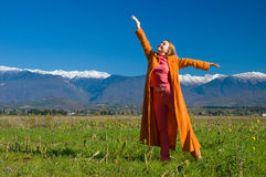 Happiness. Woman touching the skies, nice landscape stock image