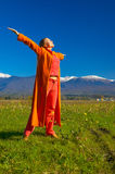 Happiness. Woman with arms wide open, nice landscape Stock Photo