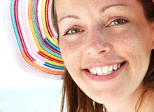 Happiness. Closeup of happy woman at the beach royalty free stock image