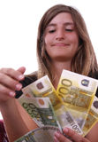 Happiness. Young girl smiling and showing a large amount of money Stock Image