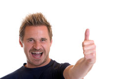Happiness. Sportive man express happiness with left thumb up Royalty Free Stock Photos