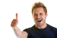 Happiness. Sportive man express happiness with right thumb up Royalty Free Stock Image