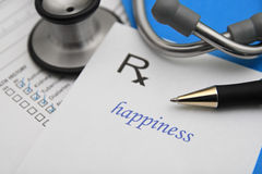 Happiness. Prescription for happiness with stethoscope Stock Photo