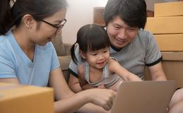 Happiness of Asian  family sitting and using laptop together wit. H technology. Smiling of Young father and mother with little kid girl. Knowledge and Learning Stock Images