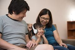 Happiness of Asian family with young father, mother and little stock photo