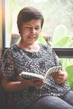 Asian senior woman reading a book. Happiness Asian senior woman reading a book Stock Image