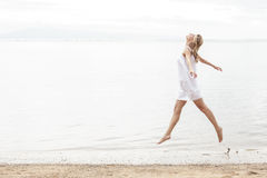 Happiness of attractive woman enjoying summer on the beach Stock Images