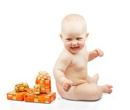 Happiness baby with gifts Stock Photos