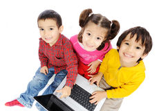 Happiness, beautiful childhood, laptop. Group of children Stock Photography