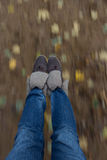 Happiness of being a kid. Lady's leg view from above with blurred leaves and ground. Selective focuse Stock Photos