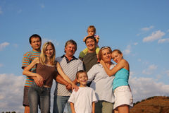 Happiness big family. Happiness large family against sky Stock Image