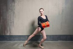 Happiness blonde laisure active dancer showing gift box royalty free stock image
