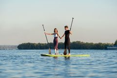 Stand up paddleboard beach people on paddle board Stock Photos