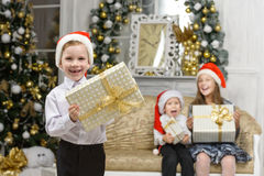 Happiness boy with x-mas gift box and smiling children Royalty Free Stock Photos