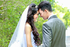 Happiness of bride and groom being together Stock Photos