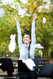 Happiness businesswoman. Throwing paper in the air, outdoor Royalty Free Stock Photos