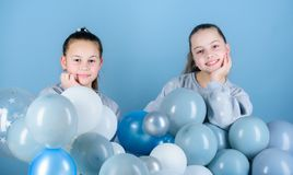 Happiness and cheerful moments. Carefree childhood. Sisters organize home party. Having fun concept. Balloon theme party. Girls best friends near air balloons royalty free stock image