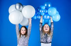 Happiness and cheerful moments. Carefree childhood. Start this party. Sisters organize home party. Having fun concept. Balloon theme party. Girls little stock photography