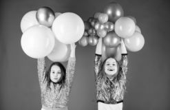 Happiness and cheerful moments. Carefree childhood. Start this party. Sisters organize home party. Having fun concept. Balloon theme party. Girls little stock images