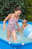 Happiness children at pool Stock Image