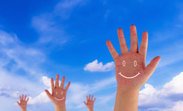 Happiness Concept Background. Happiness concept, hand and drawing smile on blue sky background stock photography