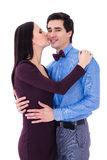Happiness concept - happy young woman kissing her husband isolat Stock Photography