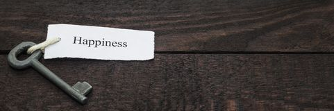 Key to Happiness. Happiness concept. Key to Happiness on wood royalty free stock photo