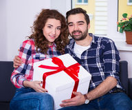 Happiness concept - young couple with big gift box Stock Photos