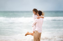 Happiness couple on beach Stock Photos