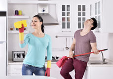 Happiness couple after cleaning the house Stock Image
