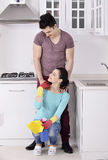 Happiness couple after cleaning the house Stock Images
