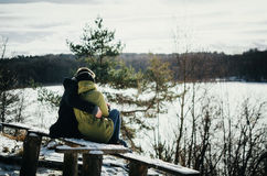 Happiness couple embraces. Young man hugs girl in winter Royalty Free Stock Photos