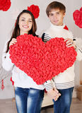 Happiness couple holding big heart Royalty Free Stock Image