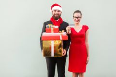 Happiness couple after shopping. Showing gifts, box and discount Royalty Free Stock Image