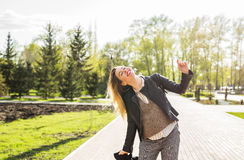 Happiness and craziness. Smiling crazy girl have fun outdoor. Young attractive woman with waving long hair playing in Royalty Free Stock Images